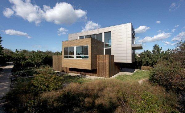 Fachad de casa de playa con una dinamica integración volúmenes en su estructura por SPG Arquitectos