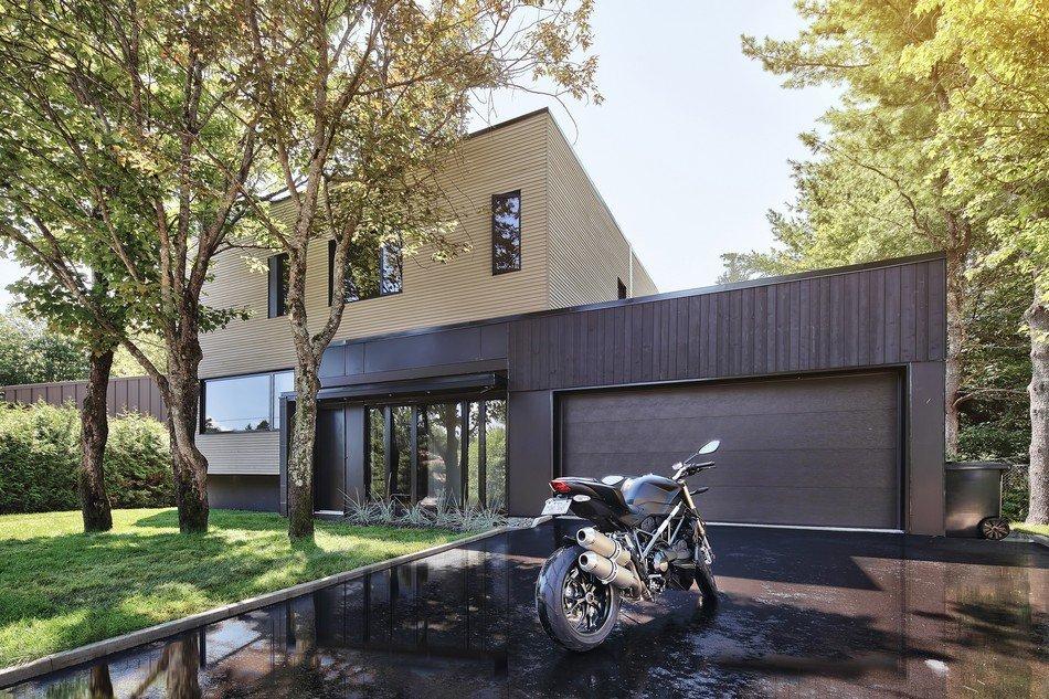 Planos de una casa moderna tipo bungalow en Québec : Casa Lausanne
