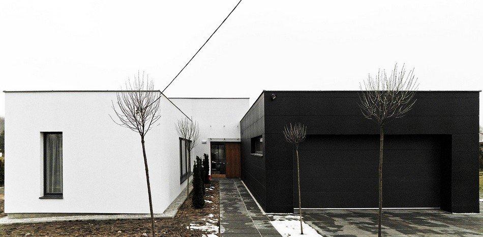 Planos de una residencia en Negro y Blanco con optimización de Luz y Espacio: Casa The Sun